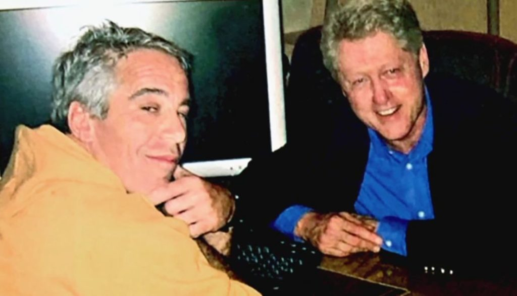 Jeffrey Epstein and Bill Clinton at a table together