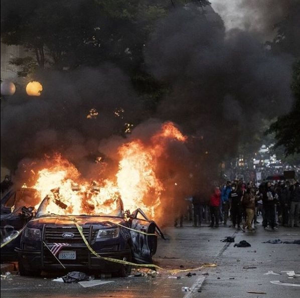 Seattle cop car on fire during protest 30 May 2020