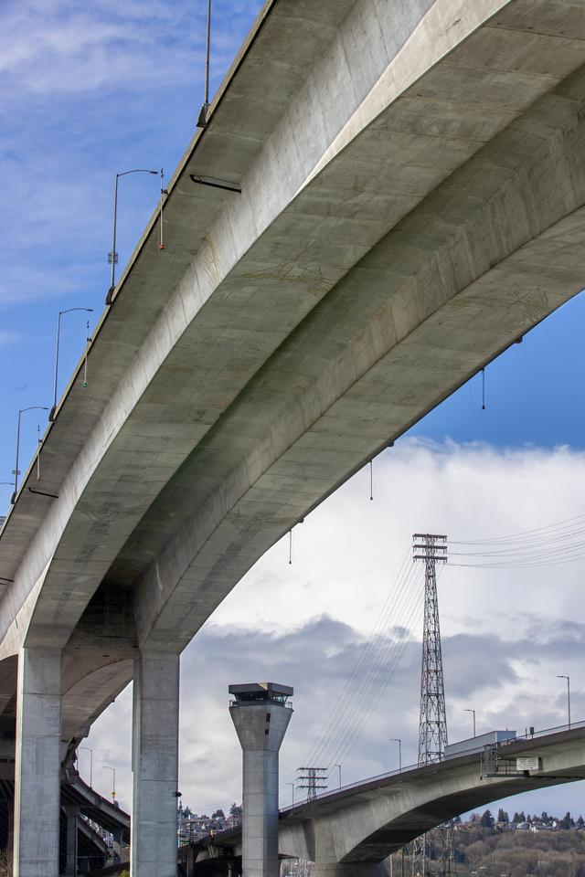 An image of the West Seattle Bridge from below, an angle that makes it seem large and soaring