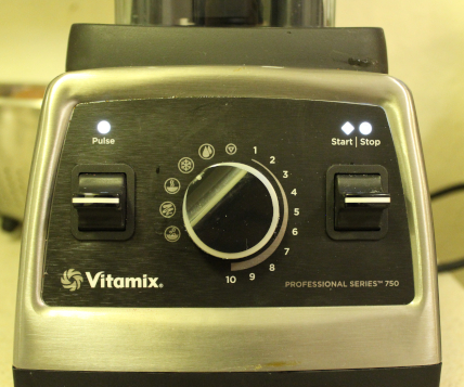 The photo shows a close-up of the Vitamix Professional 750 area of dials and switches.