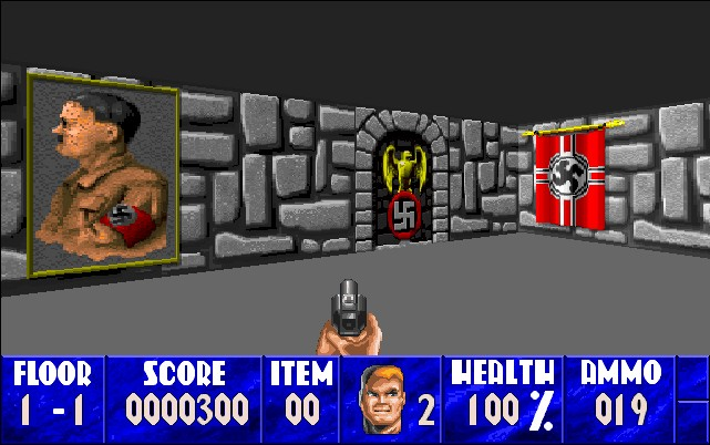 The image shows a screenshoot from the game. It's a low-tech three-dimensional shooter from the first person perspective. The player sees their gun. They're in a stone castle, where images of swastikas and Hitler decorate the walls.