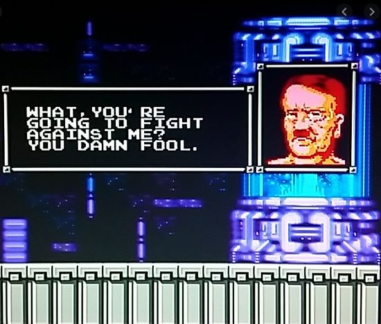 "The image is from the video game. It shows Hitler's face as he's being resurrected out of some sci-fi cryo chamber. According to the dialogue box, he's saying to the player:  ""What, you're going to fight against me? You damn fool."""