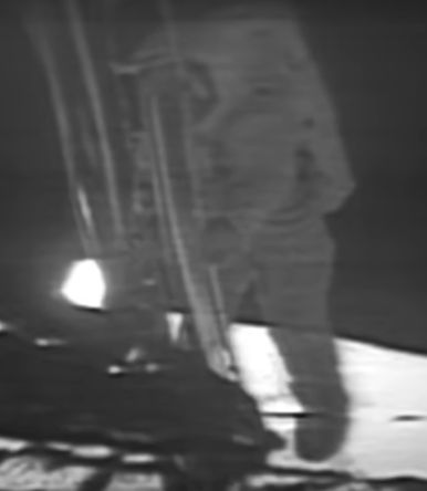 The black-and-white footage clip shows Neil Armstrong walking down the ladder of the Apollo 11 lunar module.