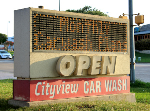 A streetside sign for Cityview Car Wash advertises monthly carwash plans