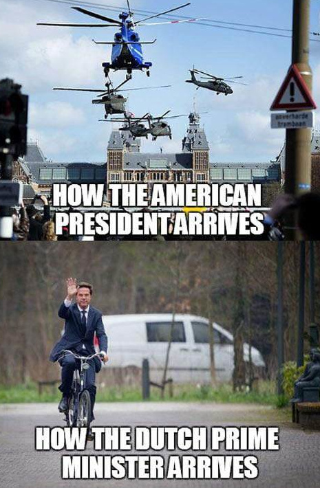 Meme. Top half shows helicopters arriving at what I assume is some Dutch government building. Top half is labelled: How the American president arrives. The bottom half shows a guy in a suit waving and riding a bicycle. It's labelled: How the Dutch Prime Minister arrives.