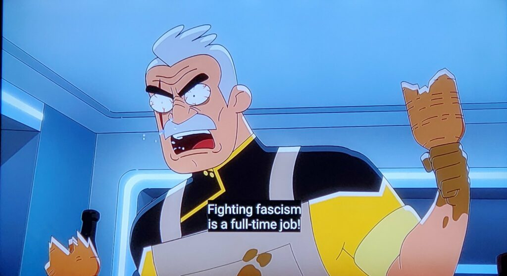 """Screenshot from an anime shows an angry male character saying: """"Fighting fascism is a full-time job!"""""""